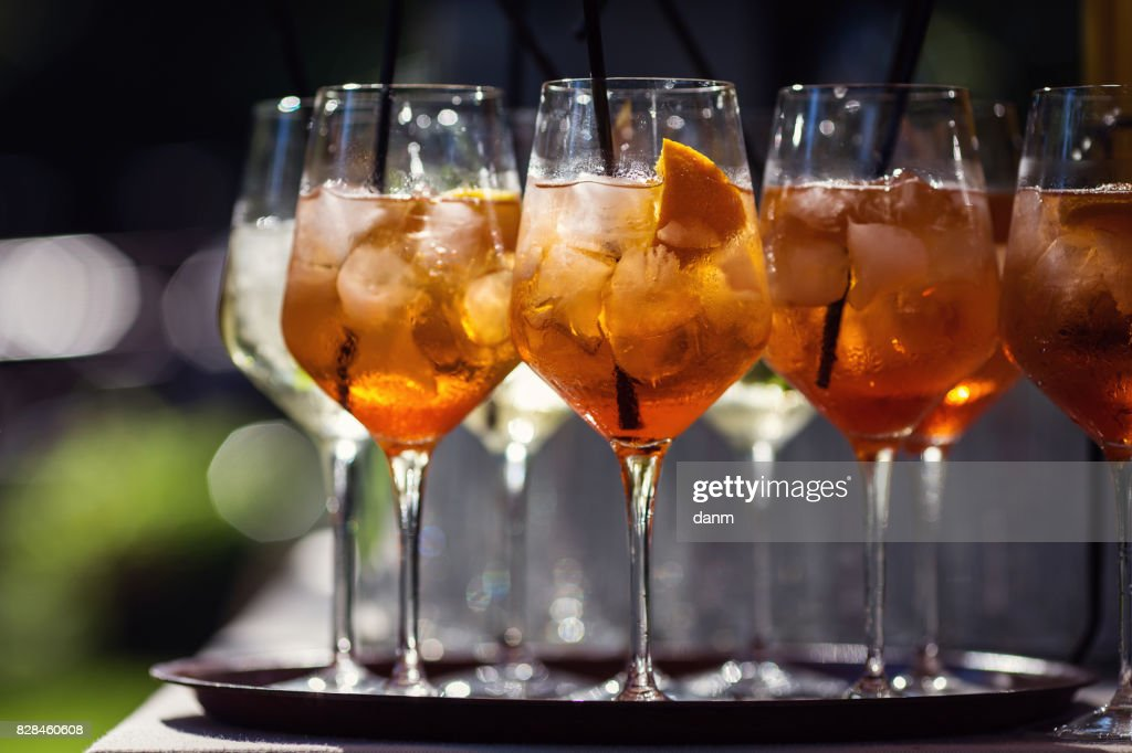Many glasses with orange cocktails, black background : Foto stock