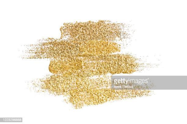 many golden brushstrokes - goldfarbig stock-fotos und bilder