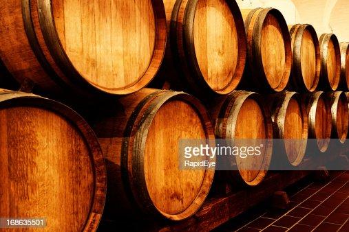 stacked oak barrels maturing red wine. Keywords Stacked Oak Barrels Maturing Red Wine .