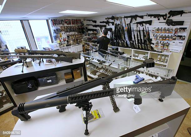 Many guns including AR-15's sit on display ready for sale at Ready Gunman on June 17, 2016 in Springville, Utah. Semi-automatics are in the news...