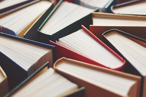 Many hardbound books background, selective focus 1209683444