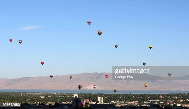Many hot air balloons are launched at sunrise to kick off the Provo Freedom Festival Parade activities on July 4, 2018 in Provo, Utah. This is one of...