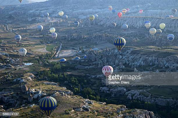 Many hot air balloons seen from above in the morning in Cappadocia Turkey