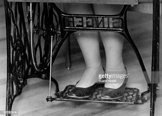 JUL 3 1973 JUL 10 1973 JUL 15 1973 Many hours of treadling on a vintage Singer sewing machine helped Mrs Mario lona win a new Touch and Sew ZigZag...