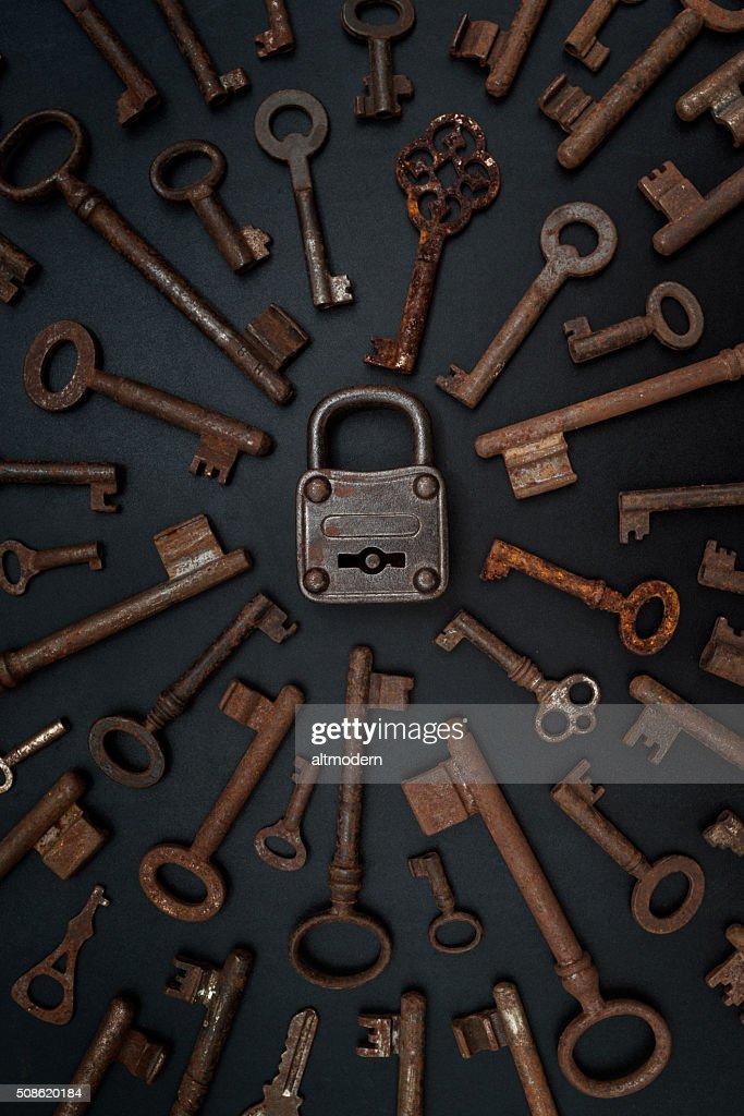 many keys on a blackboard with padlock : Stock Photo