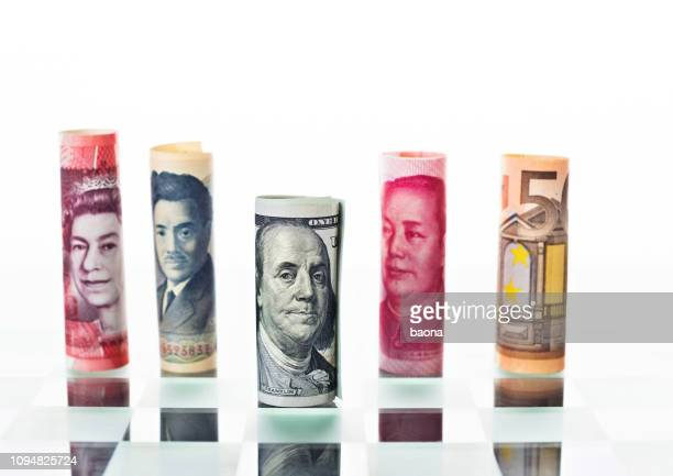 many kinds of currencies on chess board - fifty pound note stock pictures, royalty-free photos & images