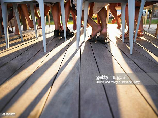 Many legs under table casting shadows