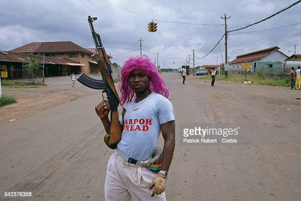 Many members of the National Patriotic Front of Liberia don unusual outfits for spiritualistic reasons or scare tactics like this young man who poses...