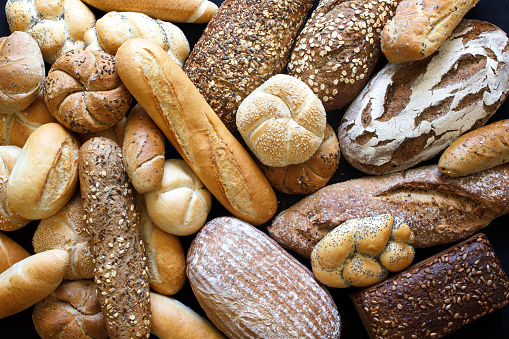 Many mixed breads and rolls shot from above. 475263838