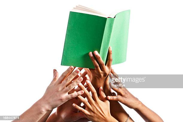 Many mixed hands reach for green-covered book against white