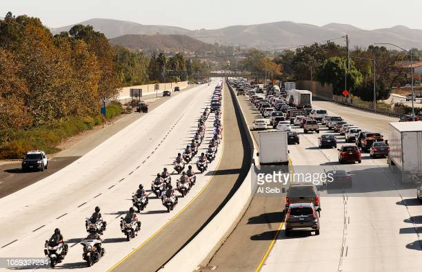 Many motor officers followed a hearse carrying the flag draped casket in a procession for Ventura County Sheriff's Sgt Ron Helus from the Borchard...
