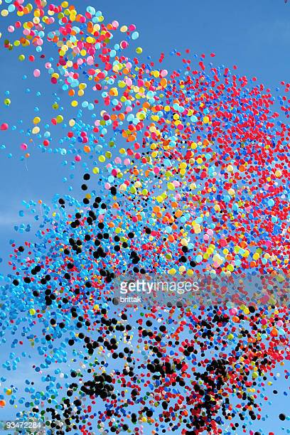 many multi colored party balloons against the blue sky. celebration. - releasing stock pictures, royalty-free photos & images