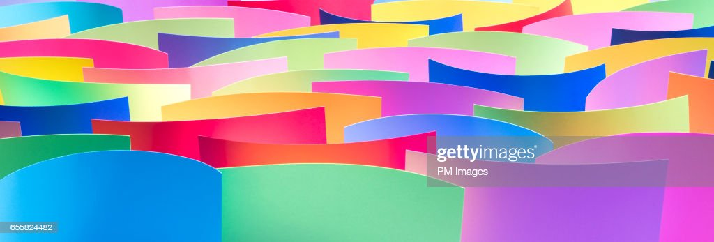 Many Multi Colored Sheets Of Paper Close Up Stock Photo | Getty Images