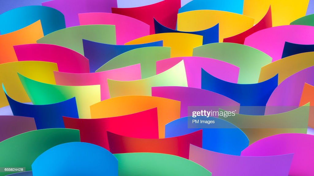 Many Multi Colored Sheets Of Paper On Edge Stock Photo | Getty Images