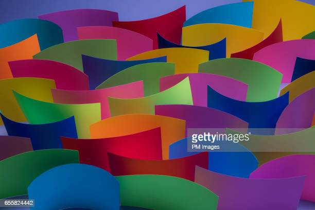 Many multi colored sheets of paper on edge