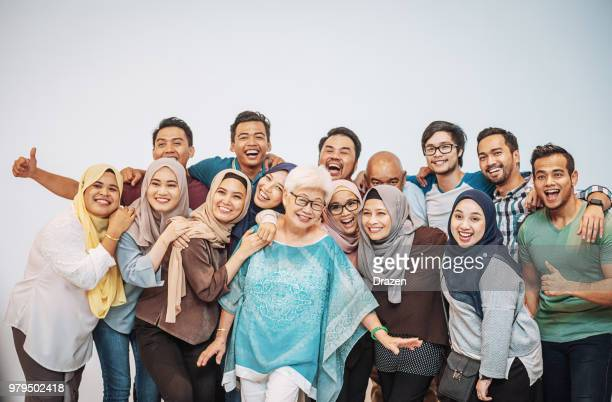 many multi ethnic people having fun - malaysia beautiful girl stock photos and pictures