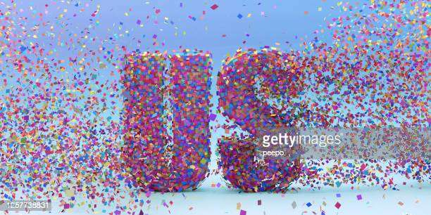 """many multi-coloured square particles coming together to make word """"us"""" - participant stock pictures, royalty-free photos & images"""