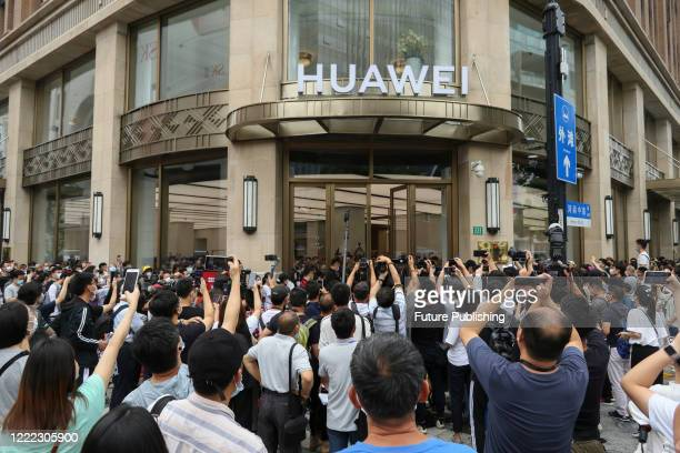 SHANGHAI CHINA JUNE 24 2020 Many multimedia reporters photographers and cameramen were present to shoot and interview the opening of Huawei's global...