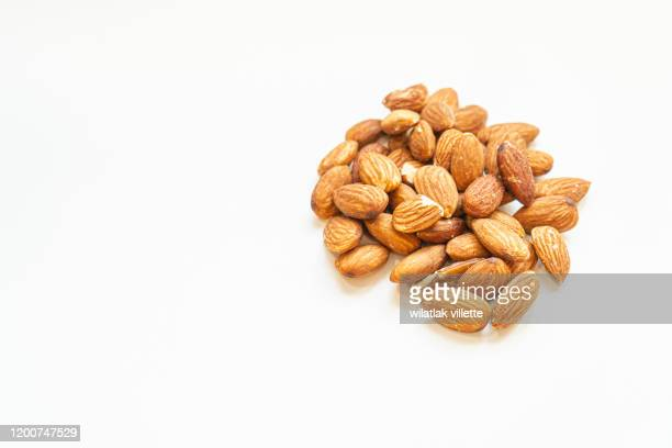 many nuts healthy fat and protein food and snack, ketogenic diet food - almond stock pictures, royalty-free photos & images