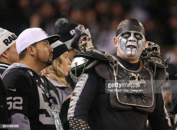 Many Oakland Raiders fans get into the spirit with their costumes as they watch the Dallas Cowboys play the Oakland Raiders on Sunday Dec 17 2017 at...
