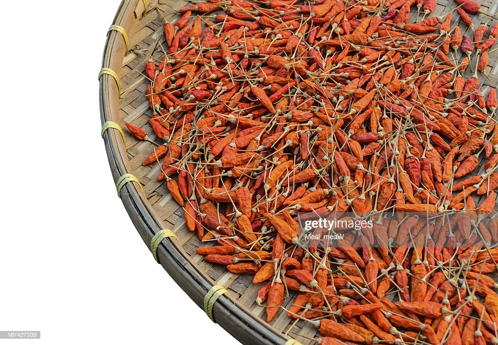 Many of red hot chili pepper on basket wood : Stock Photo