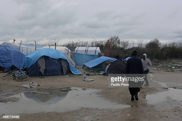 Many of the paths in and around the new Jungle refugee camp contain large puddles due to recent heavy rain Over 6000 people are living in make shift...