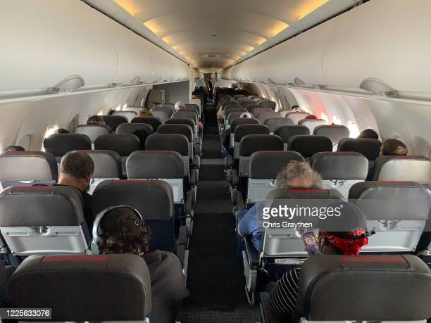Many of the seats aboard an American Airlines flight from New Orleans to Charlotte North Carolina are seen on May 15 2020 Air travel is down an...