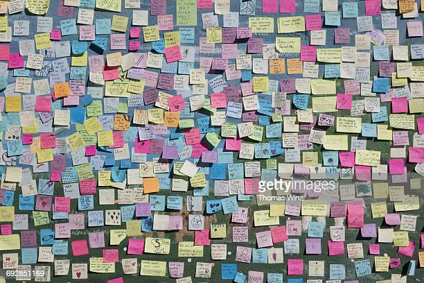 Many Paper stickers on a wall