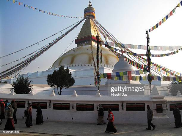 Many people are praying and turning around the tower in early morning. Boudhanath, Kathmandu Valley, Nepal, January, 2009.