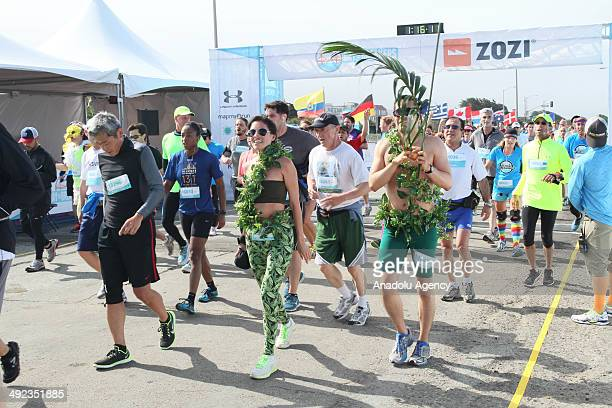 Many people attend the San Francisco Bay to Breakers race which is the oldest consecutively run annual footrace in the world a staple to the City by...