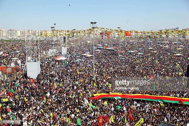 Many people gather to celebrate this year's Nowruz Day a spring festival at the Nowruz Park in Baglar a district of Diyarbakir southeastern Turkey on...