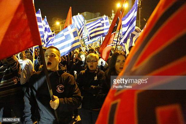 Many people of the crowd wave Greek and Golden Dawn flags Members of the rightwing Golden Dawn party rallied in central Athens to remember the three...