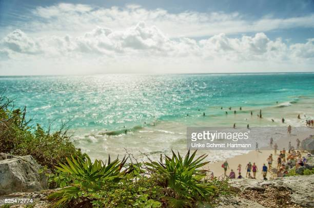 many people on a beach - tulum mexico stock photos and pictures