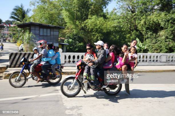 many people on motorbikes - moped stock photos and pictures