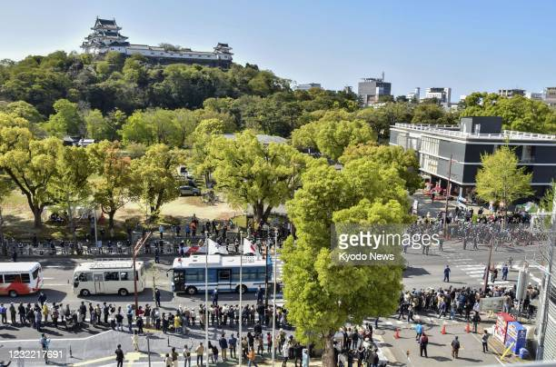 Many people take to the streets in Wakayama, western Japan, on April 10 to observe the Tokyo Olympic torch relay amid continued worries about the...