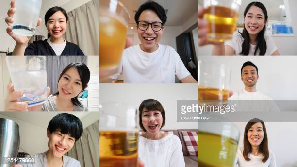 many people toasting together in virtual happy hour - happy hour stock pictures, royalty-free photos & images