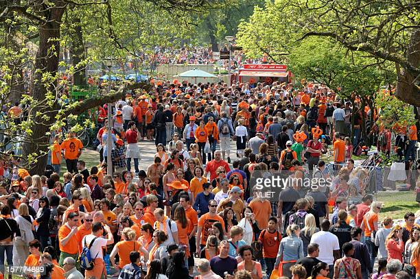 many people walking in the vondelpark on queen's day - king's day netherlands stock pictures, royalty-free photos & images