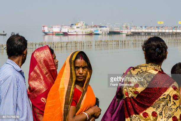 Many pilgrims are waiting for the ferry boat to Ganga Sagar Island in the Gulf of Bengal at the jetty in Kakdwip