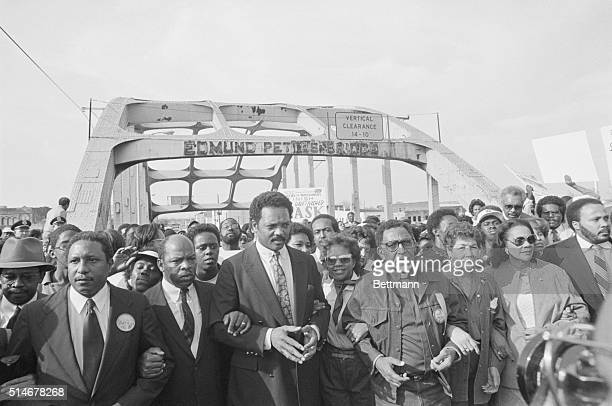 Many prominent civil rights activists cross the Edmund Pettus Bridge in a reenactment of the Selma to Montgomery march on the 20th anniversary in...