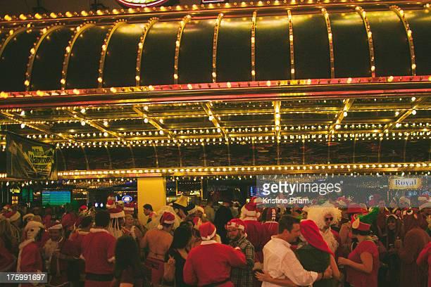 Many Santa Claus and Elves celebrating in Las Vegas
