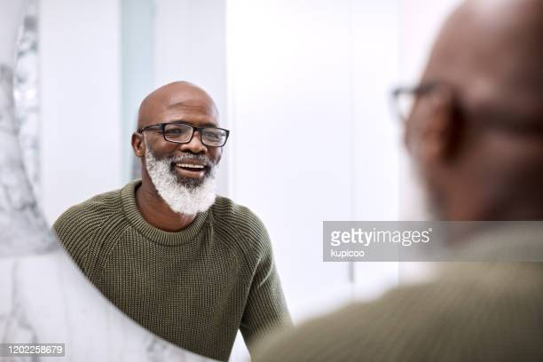 many say that i look quite good for my age - china: through the looking glass stock pictures, royalty-free photos & images
