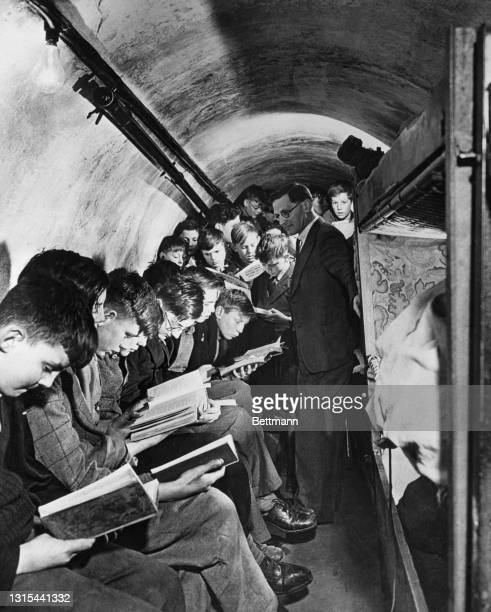 Many schools in England went underground during the war. Here is one such schoolroom during a class session. Nurseries and hospitals took to the...