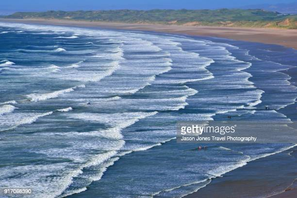 many sets of waves rolling in - gower peninsula stock photos and pictures