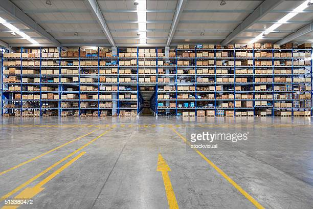 Many shelves of cardboard boxes in storehouse