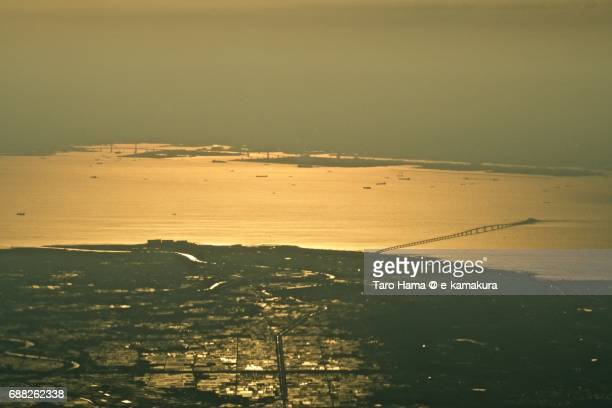 Many ships on Tokyo Bay and Tokyo Bay Aqua Line sunset time aerial view from airplane