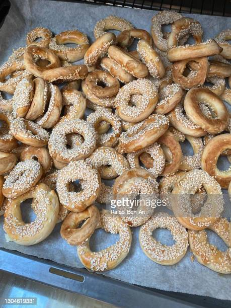 many small bagels on a tray in kitchen oven - rafael ben ari stockfoto's en -beelden