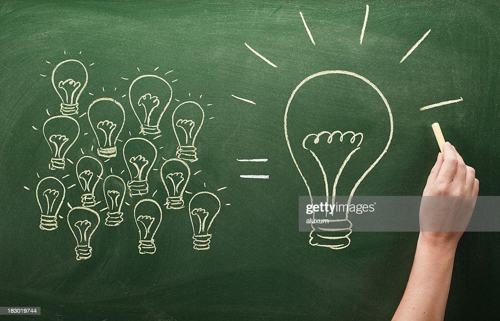 many small light bulbs equal big one : Stock Photo