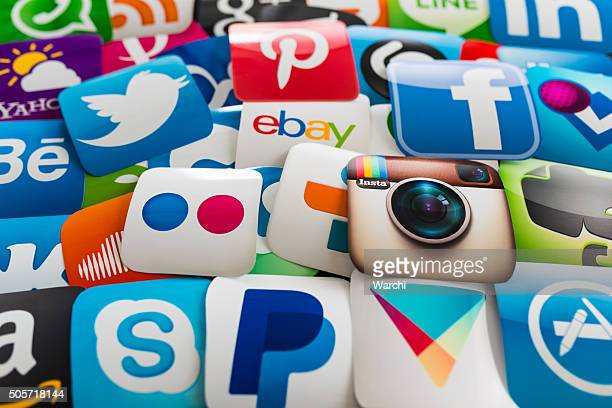 many social media icons printed on paper - marketing icons stock photos and pictures