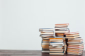 many stacks of educational books at home preparing for exams on a white background