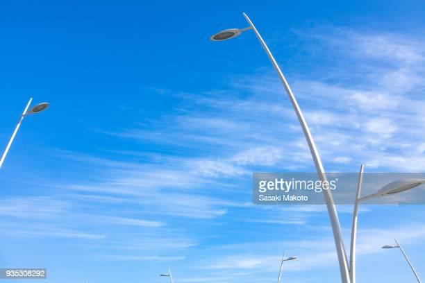 many street lights on a sunny day